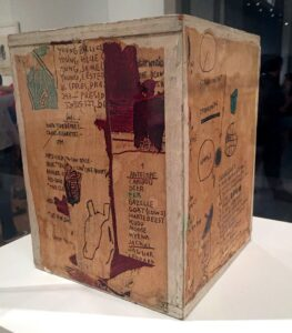 EL 135.07 Jean-Michel Basquiat Untitled 1985 Xerox collage on wood box 11 1/8 x 8 1/2 in.